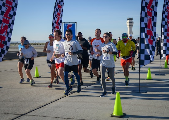 Competitors take off at the start of the Run with History Half Marathon, 10k and 5k at Edwards Air Force Base, Calif., May 18. (U.S. Air Force photo by Giancarlo Casem)