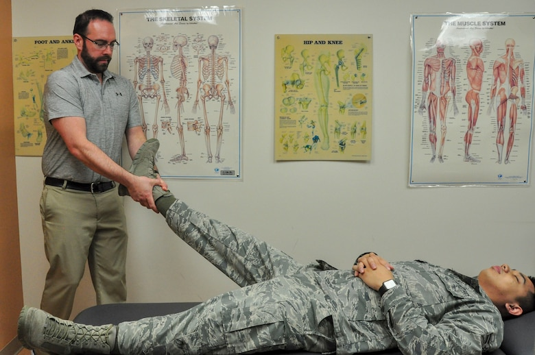 Dr. Jason Wheeler, 359th Medical Operations Squadron Physical Therapy Flight physical therapist, performs hip manipulation on Airman 1st Class Albert Lapera, 359th Medical Group physical therapy technician, to demonstrate one type of physical therapy used to help patients with arthritis. Arthritis Awareness Month, which is observed in May, is a time to motivate people, especially those with arthritis, to become more physically active.