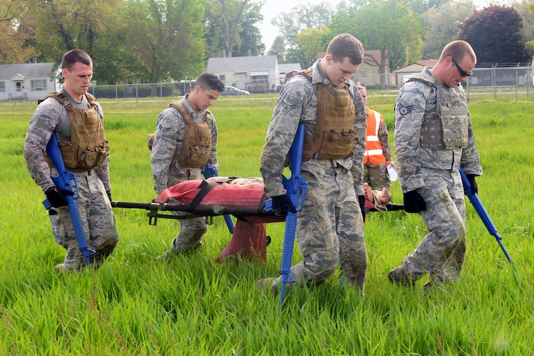 Participants of the Raider Challenge perform a casualty evacuation carrying fifty pounds of sandbags through an obstacle course at Offutt Air Force Base, Nebraska, May 15, 2019. In 1962, President John F. Kennedy signed a proclamation which designated on May 15 as Peace Officers Memorial Day and the week in which that date falls as Police Week. (U.S. Air Force photo by Kendra Williams)
