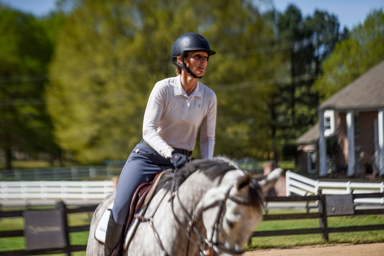 She grew up a horse loving and riding kid in Northern California and put her dream of riding professionally on hold when she enlisted and later commissioned into the Air Force.