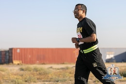 Staff Sgt. Zafar Iqbal, 184th Sustainment Command, runs in the Arifjan Marathon at Camp Arifjan, Kuwait, April 14, 2019. (Courtesy photo)