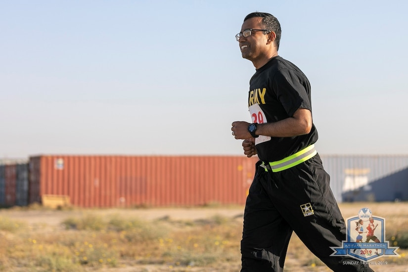 Staff Sgt. Zafar Iqbal, 184th Sustainment Command, runs in the Arifjan Marathon at Camp Arifjan, Kuwait, April 14, 2019. (Courtesy photo)