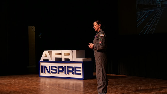 "Capt. Sarah Woody, deputy course director for the Critical Air Transport (CCAT) initial course at the United States Air Force School of Aerospace Medicine, presents her Inspire talk, entitled, ""Thought for Food."" (U.S. Air Force photo/Keith Lewis)"