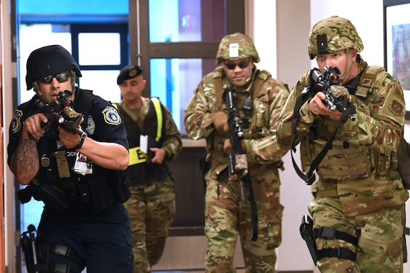 SCHRIEVER AIR FORCE BASE, Colo.--50th Security Forces Squadron members respond to a simulated threat scenario during the Front Range Expeditionary Exercise in Building 210 at Schriever Air Force Base, Colorado, April 25, 2019. Actions carried out by 50th SFS members in exercise and in real time are supported by the efforts of the 50th SFS anti-terrorism flight, who are responsible for maintaining the force protection measures for all of Schriever AFB as well as off-site facilities within the Front Range and geographically separated units around the world. (U.S. Air Force photo by Dennis Rogers)