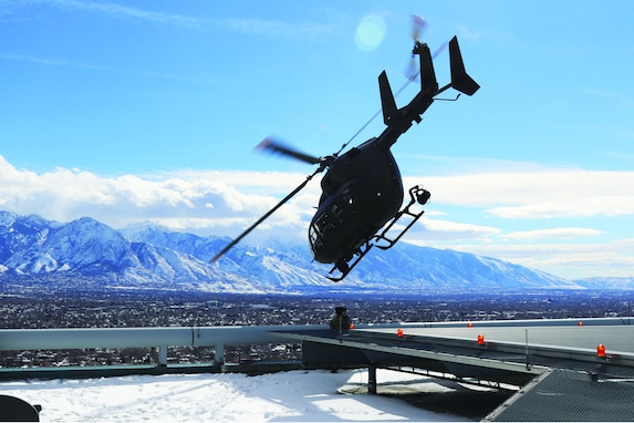 A UH-72 Lakota takes off from the helipads of the Wells Fargo building in Salt Lake City