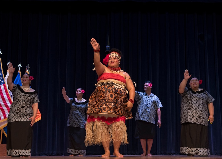 Members of the Le Tausa'afia dance group perform a traditional Samoan dance during a ceremony in honor of Asian American and Pacific Islander Heritage Month at Joint Base Langley-Eustis, Virginia, May 21, 2019.