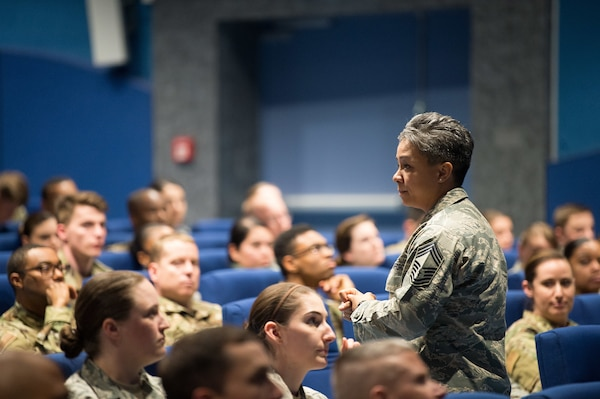 Air Force Chief Master Sgt. Rebecca Baxter, Air Force Personnel Center superintendent of personnel operations directorate, discusses enlisted personnel matters at the AFPC Roadshow Town Hall at the Hercules Theater, May 13, 2019 at Ramstein Air Base, Germany. During the town hall, AFPC briefers spoke to 86th Airlift Wing military and civilians on changes to processes and policies regarding personnel matters.