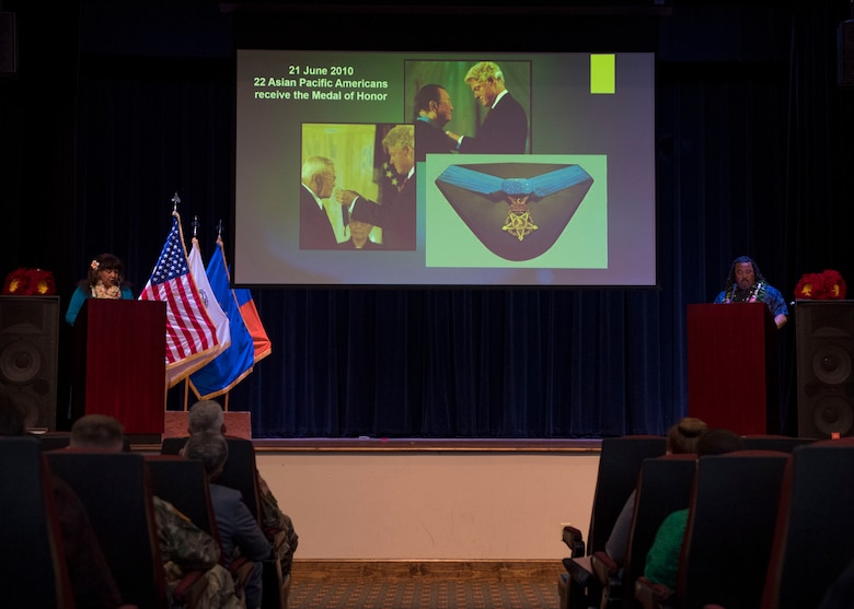 Guest speakers discuss military accomplishments during a ceremony in honor of Asian American and Pacific Islander Heritage Month at Joint Base Langley-Eustis, Virginia, May 21, 2019.