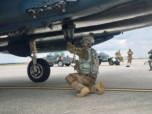 Tech. Sgt. Steven Wilson, 4th Logistics Readiness Squadron air transportation craftsman, performs hot-pit refueling of an F-15E during the Combat Support Wing capstone, May 9, 2019, at MacDill Air Force Base, Florida. The CSW provides multifunctional training for Airmen to rapidly deploy in smaller, more efficient and agile teams, effectively creating a smaller footprint in dangerous or non-permissive areas.