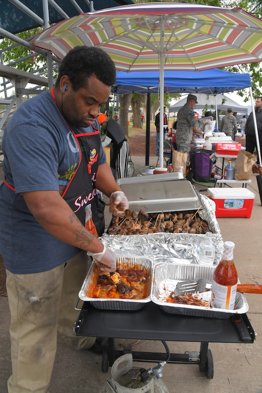 Jonny Greg, prepares traditional island bar-bq during the Asian American Pacific Islander Heritage festival, held May 16 at the softball fields, Hill Air Force Base, Utah. The annual event is part of AAPI Heritage Month celebrating the cultural traditions, ancestry, native languages, and unique experiences represented among more than 50 ethnic groups speaking more than 100 languages from Asia and the Pacific Islands. (U.S Air Force photo by Todd Cromar)