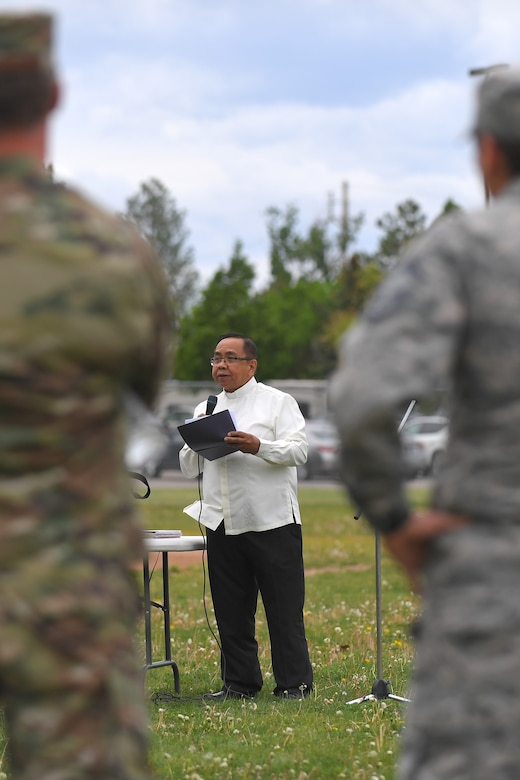 Father Max Omana, Catholic Priest at the base chapel, addresses guests as the guest speaker during the Asian American Pacific Islander Heritage festival, held May 16 at the softball fields, Hill Air Force Base, Utah. The annual event is part of AAPI Heritage Month celebrating the cultural traditions, ancestry, native languages, and unique experiences represented among more than 50 ethnic groups speaking more than 100 languages from Asia and the Pacific Islands. (U.S Air Force photo by Todd Cromar)