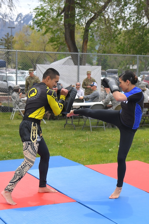 (left to right) Staff. Sgt. Von Carios, 75th Medical Group, and Tech. Sgt. Tiffany Carios, 729th Air Control Squadron, participate in a Tai Kwan Do demonstration, during the Asian American Pacific Islander Heritage festival, held May 16 at the softball fields, Hill Air Force Base, Utah. The annual event is part of AAPI Heritage Month celebrating the cultural traditions, ancestry, native languages, and unique experiences represented among more than 50 ethnic groups speaking more than 100 languages from Asia and the Pacific Islands. (U.S Air Force photo by Todd Cromar)