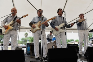 """Surfin'"", The Beach Boys Tribute band, perform during the California Dreaming Spring Block Party May 18, 2019, at Travis Air Force Base, California. The 60th Air Mobility Wing chaplain's office hosts quarterly block parties to promote goodwill and camaraderie among Travis Airmen and their families. (U.S. Air Force photo by Airman 1st Class Cameron Otte)"