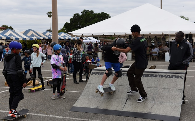 A skateboarding team called Skatedogs teach children how to ride skateboards during the California Dreaming Spring Block Party May 18, 2019, at Travis Air Force Base, California. The 60th Air Mobility Wing chaplain's office hosts quarterly block parties to promote goodwill and camaraderie among Travis Airmen and their families. (U.S. Air Force photo by Airman 1st Class Cameron Otte)