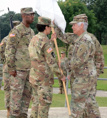 Col. Shauna L. Snyder (right), commander, Medical Professional Training Brigade at Joint Base San Antonio-Fort Sam Houston, passes the unit colors to Command Sgt. Maj. Jennifer A. Redding at an assumption of responsibility ceremony held at the Army Medical Department Museum May 22.