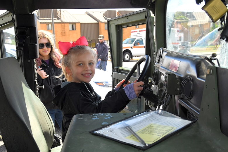 Lila Eccles watches as daughter Zoey Eccles sits in a HUMVEE at the Wheels of Wonder event, May 17, 2019, Hill Air Force Base, Utah. (U.S. Air Force photo by Todd Cromar)
