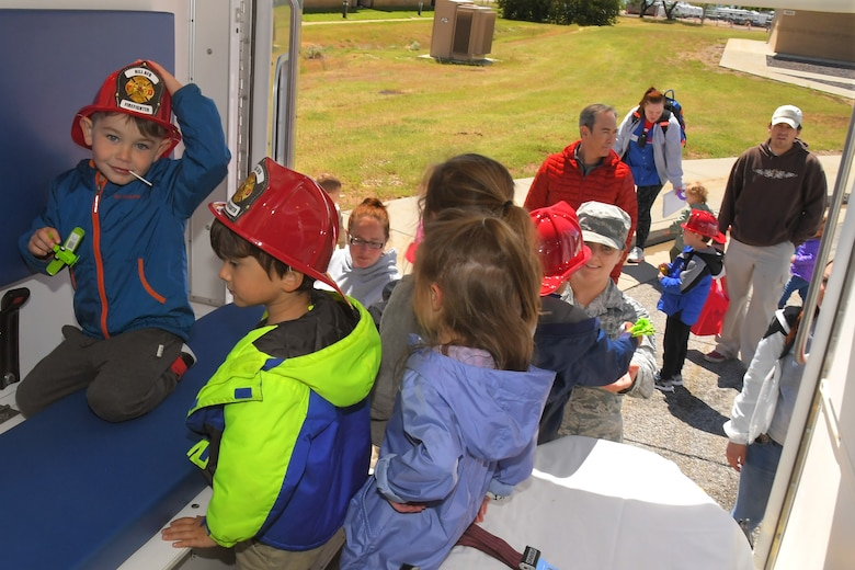 Children get a chance to see the inside of an Ambulance, with the help of Tech Sgt. Jessica Flynn, 75th Medical Group at the Wheels of Wonder event, May 17, 2019, Hill Air Force Base, Utah. (U.S. Air Force photo by Todd Cromar)