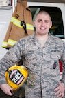 U.S. Air Force Staff Sgt. Michael Ginikos, crew chief in the fire department at the 121st Air Refueling Wing, stands for a portrait May 5, 2019, at Rickenbacker Air National Guard Base, Ohio. Ginikos won the 2018 Chief Albert Fitzpatrick Award for Air National Guard Firefighter of the Year.