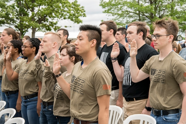 Recruits from the 434th Air Refueling Wing at Grissom Air Reserve Base, Indiana recite the oath of enlistment during a mass enlistment ceremony at the Indianapolis Motor Speedway May 19, 2019. The oath of enlistment is a military oath made by members of the United States armed forces who are not commissioned officers. (U.S. Air Force photo/Master Sgt. Ben Mota)