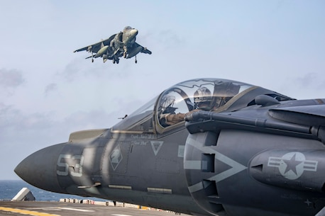 ARABIAN SEA (May 18, 2019) AV-8B Harriers return to the flight deck of the Wasp-class amphibious assault ship USS Kearsarge (LHD 3) after participating in an exercise with F/A-18E Super Hornets embarked aboard the Nimitz-class aircraft carrier USS Abraham Lincoln (CVN 72). The Abraham Lincoln Carrier Strike Group (ABECSG) and Kearsarge Amphibious Ready Group (KSGARG) are conducting joint operations in the U.S. 5th Fleet area of operations. The ABECSG and KSGARG, with the 22nd Marine Expeditionary Unit, are prepared to respond to contingencies and to defend U.S. forces and interests in the region. (U.S. Navy photo by Mass Communication Specialist 2nd Class Megan Anuci/Released)
