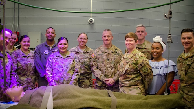 Army Command Sergeant Major John Wayne Troxell visits with the Aeromedical Evacuation Squadron during his visit to Pope - one of several stops on base.