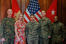 Brig. Gen. James F. Glynn, the Commanding General of Marine Corps Recruit Depot Parris Island, and Sgt. Maj. William Carter, the depot Sergeant Major, pose for a photo with Parris Island Navy-Marine Corps Relief Society representatives on MCRD Parris Island, S.C., March 20, 2019. The NMCRS's mission is to provide financial aid, education and other assistance to members of the Naval Service of the United States, family members, and survivors in need. (U.S. Marine Corps photo by Lance Cpl. Daniel Johnson/Released)