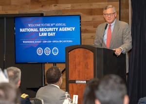Sen Burr speaks at the podium to NSA employees and guests at 2019 Law Day.