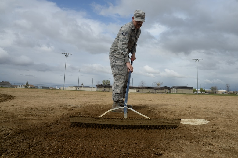 Staff Sgt. Juan Cimental, 341st Force Support Squadron sports program manager, maintains soft dirt on a softball field May 20, 2019, at Malmstrom Air Force Base, Mont.