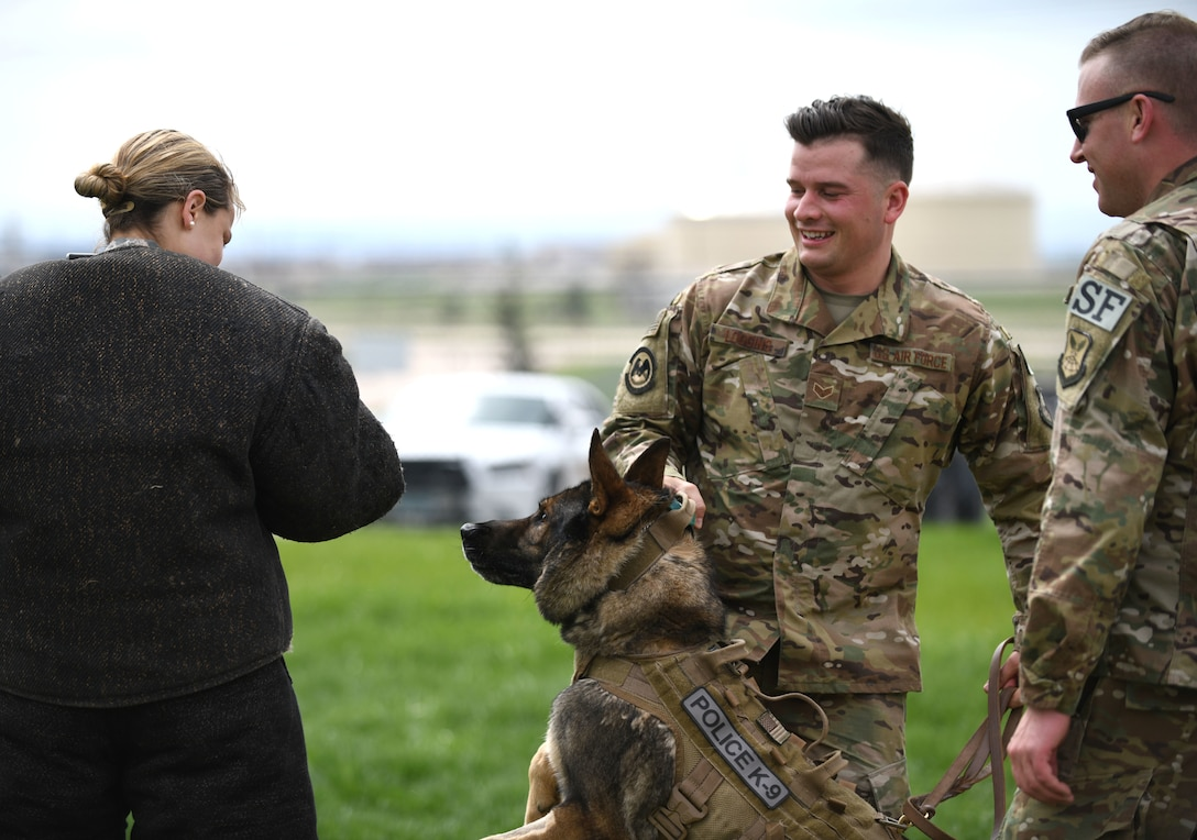 Senior Airman Chase Loggins, a 28th Security Forces Squadron military working dog handler, restrains MWD Boris during a demonstration for National Police Week on Ellsworth Air Force Base, S.D., May 16, 2019. The 28th SFS MWD competition was part of a series of events held in honor of law enforcement officers who died in the line of duty. (U.S. Air Force photo by Airman 1st Class Christina Bennett)