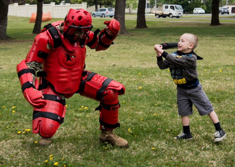 """An attendee hits U.S. Navy Seaman Rodolfo Romero, a Naval Air Facility Far East Public Works Department construction mechanic and dressed as the """"red man,"""" during Police Week 2019 at Misawa Air Base, Japan, May 15, 2019. The red man training teaches how to use a baton in combat scenarios. The red man course also covers security forces concepts, operations, weapons safety, use of lethal or non-lethal force, communication procedures and vehicle searches. (U.S. Air Force photo by Airman 1st Class Xiomara M. Martinez)"""