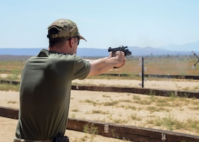 Airman 1st Class Nicholas Gurley, 412th Security Forces Squadron, participates in a shooting competition during Police Week, at Edwards Air Force Base, California, May 14. (U.S. Air Force photo by Giancarlo Casem)