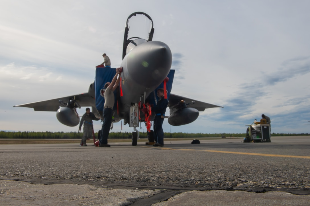 U.S. Air Force Airmen from the 44th Aircraft Maintenance Squadron conduct a post flight check on an F-15C Eagle assigned to the 44th Fighter Squadron from Kadena Air Base, Japan, during exercise Northern Edge (NE19), May 14, 2019, at Eielson Air Force Base, Alaska.