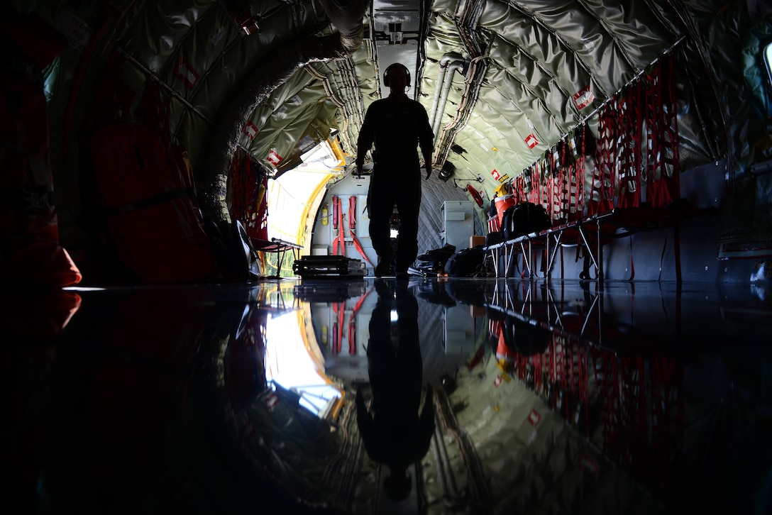U.S. Air Force Senior Airman Taylor Manz, a boom operator assigned to the 909th Air Refueling Squadron, walks through a KC-135R Stratotanker during exercise Northern Edge, May 16, 2019, at Eielson Air Force Base, Alaska.