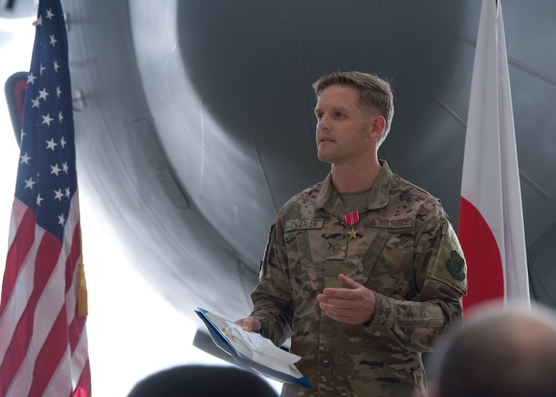 Master Sgt. James Charles, 374th Aircraft Maintenance Squadron production superintendent, speaks about receiving the Bronze Star Medal, during a ceremony held at Yokota Air Base, Japan