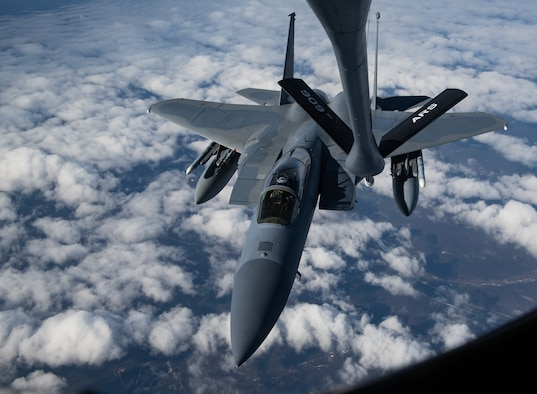 A U.S. Air Force KC-135R Stratotanker assigned to the 909th Air Refueling Squadron from Kadena Air Base, Japan, prepares to refuel an F-15C Eagle assigned to the 57th Wing from Nellis Air Force Base, Nev., during exercise Northern Edge, May 16, 2019, over Alaska.