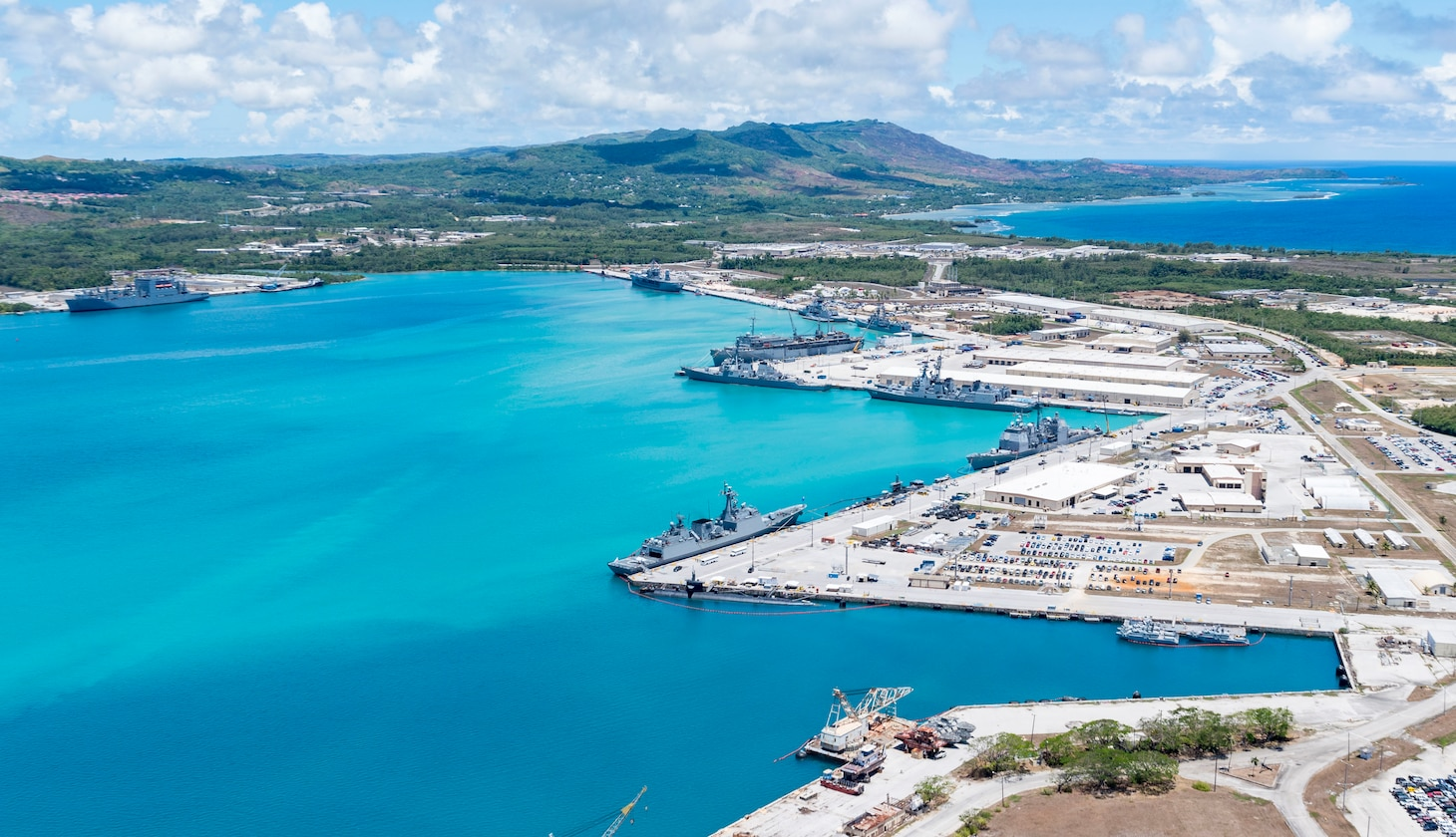190522-N-LN093-1253  SANTA RITA, Guam (May 22, 2019) – An aerial view of U.S. Naval Base Guam shows U.S. Navy, Royal Australian Navy, Japan Maritime Self-Defense Force and the Republic of Korea Navy, vessels moored in Apra Harbor, in support of Pacific Vanguard (PACVAN), May 22. PACVAN is the first of its kind quadrilateral exercise between Australia, Japan, Republic of Korea, and U.S. Naval forces. Focused on improving the capabilities of participating countries to respond together to crisis and contingencies in the region, PACVAN prepares the participating maritime forces to operate as an integrated, capable, and potent allied force ready to respond to a complex maritime environment in the Indo-Pacific region.