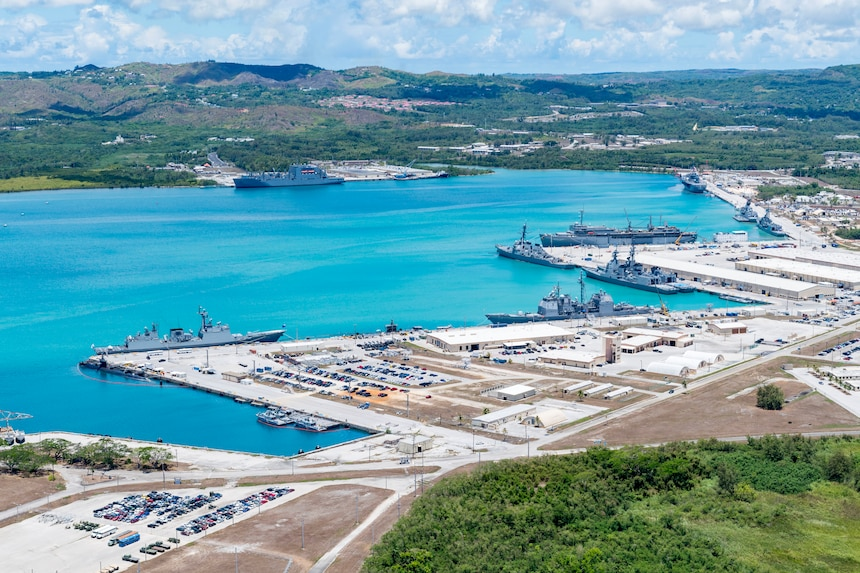 190522-N-LN093-1208  SANTA RITA, Guam (May 22, 2019) – An aerial view of U.S. Naval Base Guam shows U.S. Navy, Royal Australian Navy, Japan Maritime Self-Defense Force and the Republic of Korea Navy, vessels moored in Apra Harbor, in support of Pacific Vanguard (PACVAN), May 22. PACVAN is the first of its kind quadrilateral exercise between Australia, Japan, Republic of Korea, and U.S. Naval forces. Focused on improving the capabilities of participating countries to respond together to crisis and contingencies in the region, PACVAN prepares the participating maritime forces to operate as an integrated, capable, and potent allied force ready to respond to a complex maritime environment in the Indo-Pacific region.