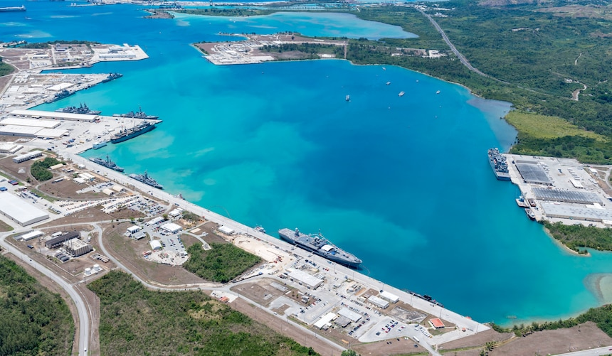 190522-N-LN093-1018  SANTA RITA, Guam (May 22, 2019) – An aerial view of U.S. Naval Base Guam shows U.S. Navy, Royal Australian Navy, Japan Maritime Self-Defense Force and the Republic of Korea Navy, vessels moored in Apra Harbor, in support of Pacific Vanguard (PACVAN), May 22. PACVAN is the first of its kind quadrilateral exercise between Australia, Japan, Republic of Korea, and U.S. Naval forces. Focused on improving the capabilities of participating countries to respond together to crisis and contingencies in the region, PACVAN prepares the participating maritime forces to operate as an integrated, capable, and potent allied force ready to respond to a complex maritime environment in the Indo-Pacific region.