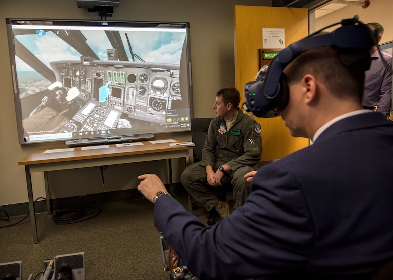 Dr. John Matyjas, science and technology advisor to Air Combat Command, tests the 41st Rescue Squadron's (RQS) virtual reality flight simulator, May 16, 2019, at Moody Air Force Base, Ga. Matyjas and Dr. Donna Joyce visited the 41st RQS to tour and assess their VR simulator along with taking a fam flight on an HH-60G Pave Hawk. The visit is a part of an Air Force assessment of the possible implementation of VR in training. The 41st RQS VR flight simulator is an initiative that was selected at the Moody Air Force Base 2018 Spark Tank competition. (U.S. Air Force photo by Airman 1st Class Eugene Oliver)