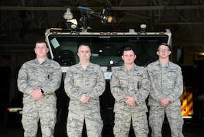 Senior Airman Ryan Younger, 14th Security Forces Squadron patrolman, Tech. Sgt. Eric Lannon, 14th Contracting Squadron contracting officer, Staff Sgt. Joshua Kenney, 14th Civil Engineer Squadron firefighter, and Senior Airman Dylan Fivecoate, 14th Operations Support Squadron air traffic controller, stand outside of the 14th CES fire station May 20, 2019, on Columbus Air Force Base, Mississippi.