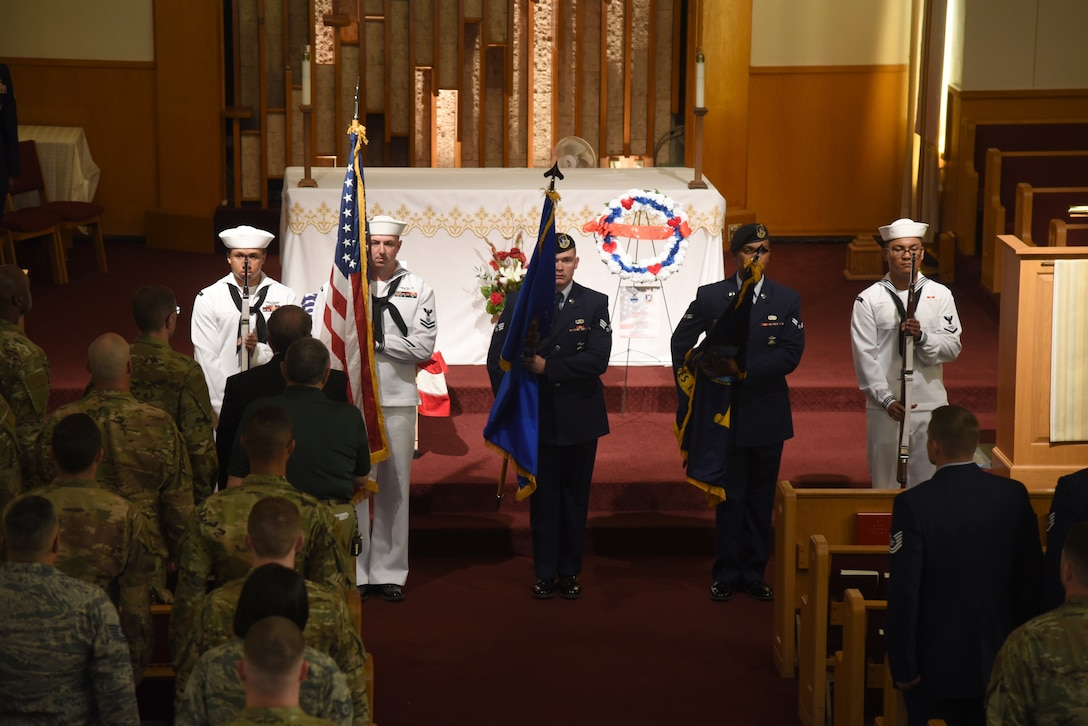 Members of the 72nd Security Forces Squadron and the Navy's Master-at-Arms served in the Honor Guard during the National Police Week Memorial Service at the Tinker Chapel May 15. The service honored the 159 military and civilian law enforcement officers and K9s that have died in the line of duty this past year. (U.S. Air Force photo/Kelly White)