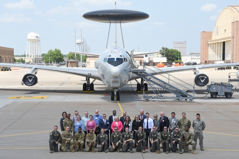 Group photo showing members of the 552nd Air Control Wing with House and Senate members of the State of Oklahoma following a tour of an E-3G Sentry Airborne Warning and Control System aircraft May 16, 2019, Tinker Air Force Base, Oklahoma. The Oklahoma legislatures learned about the E-3s systems and capabilities as the largest single unit at Tinker AFB. (U.S. Air Force photo/Greg L. Davis)