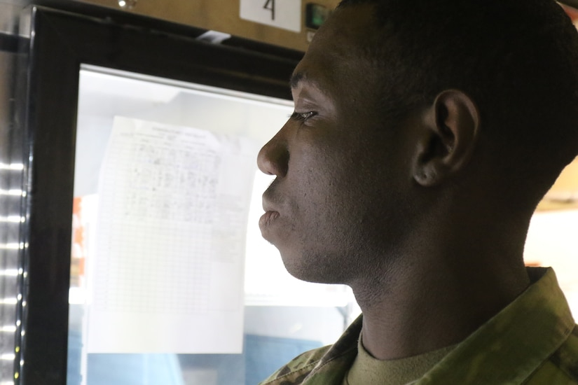 Capt. Karl Jones, 184th Sustainment Command, checks medical supplies at a warehouse at Camp Arifjan, Kuwait, May 15, 2019.