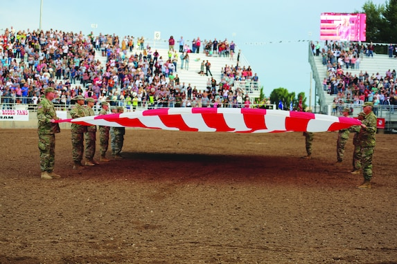 Utah National Guard Soldiers participate in the opening flag ceremony during the Ute Stampede in Nephi, Utah, July 14, 2018