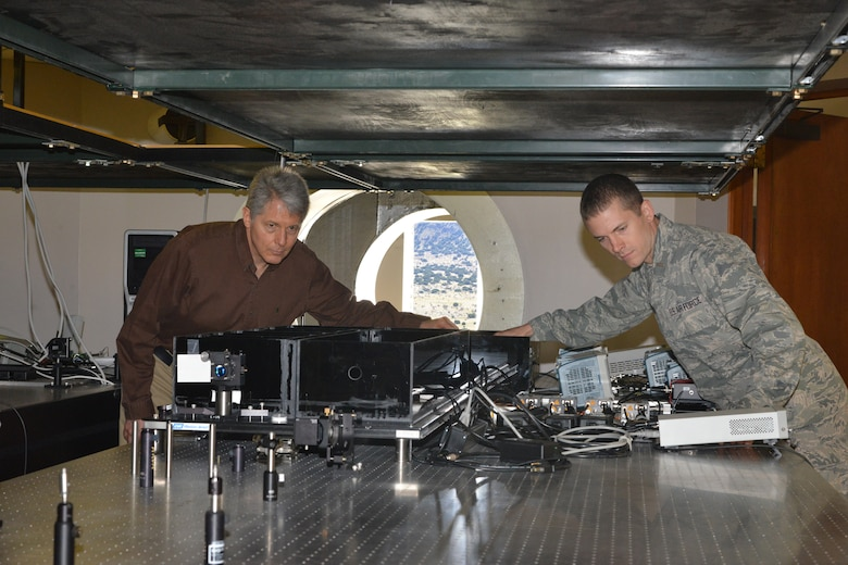 Air Force Research Laboratory researchers Dr. Mark Gruneisen and 2nd Lt. Eddie Hilburn make adjustments to the quantum key distribution testbed at the Starfire Optical range propagation site. (U.S. Air Force photo/Todd Berenger)