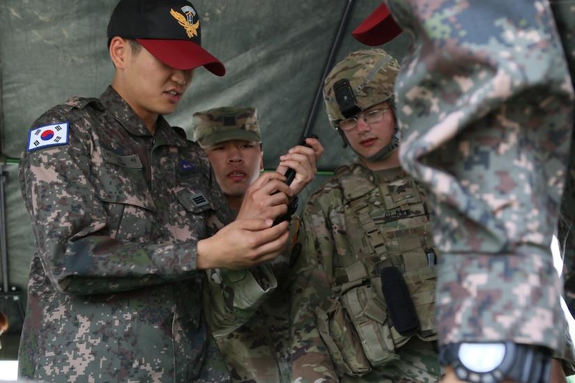 American, South Korean service members work together.