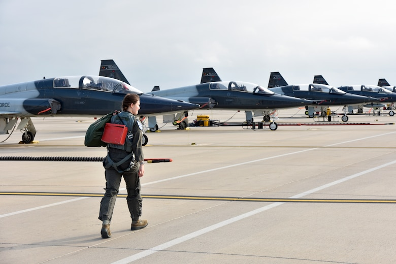 1st Lt. Claire Latscha, a 87th Flying Training Squadron instructor pilot, moves to an aircraft for a training mission at Laughlin Air Force Base, Texas, May 17, 2019. Latscha helped the 19th Air Force pen new techniques for aviators flying in the T-38C Talon airframe, helping to strengthen the Specialized Undergraduate Pilot Training program for the fighter aircraft track and is now used across all of Air Education and Training Command. (U.S. Air Force photo by Senior Airman John A. Crawford)