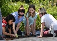 Children, volunteers dig into Youth Center Community Garden