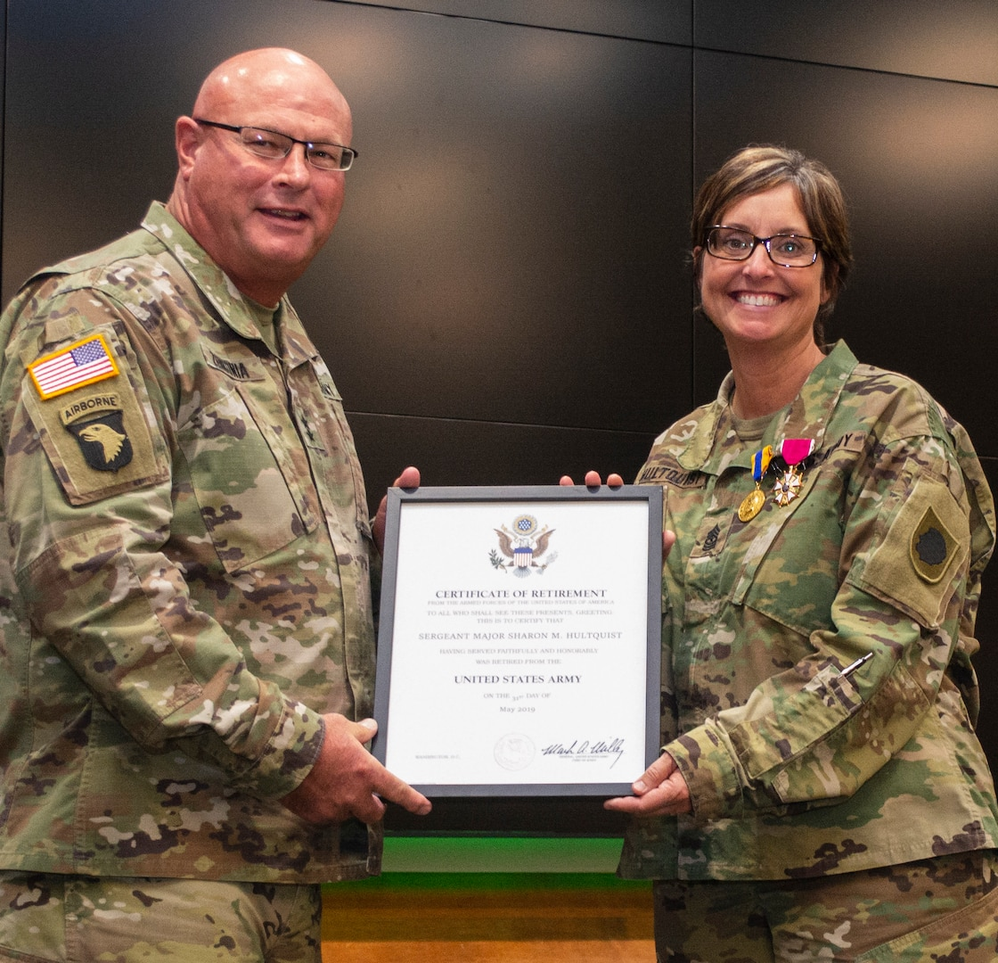 Maj. Gen. Michael Zerbonia, Assistant Adjutant General – Army and Commander, Illinois Army National Guard, presents Sgt. Maj. Sharon Hultquist, of Delavan, Illinois, with the Certificate of Retirement from the U.S. Army during Hultquist's retirement ceremony May 17 at the Illinois Military Academy, Camp Lincoln, Springfield, Illinois. Hultquist retires from the military May 31 after more than 30 years of service. (U.S. Army photo by Barbara Wilson, Illinois National Guard Public Affairs Office)