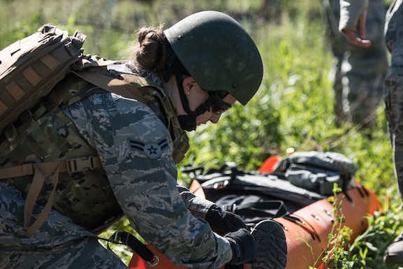 U.S. Air Force Airman 1st Class Kayla Rhodes, a medic with the 193rd Special Operations Medical Group Detachment 1, Pennsylvania Air National Guard, secures a casualty on a litter during Tactical Combat Casualty Care training.